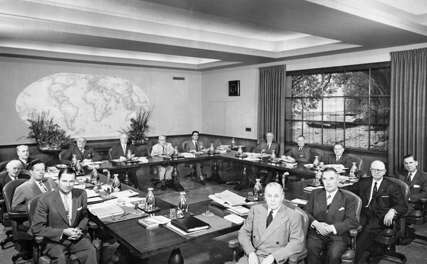 The 1955-56 Board of Directors. Clockwise from bottom left: Dan Procter, Kenneth G. Partridge, Spencer J. Hollands, Alejandro Garreton Silva, Alphonse Fievez, Allin Winston Dakin, Joseph A. Abey, Ernesto Imbassahy de Mello, O.D.A. Oberg, A.Z. Baker, George R. Means, Roy D. Hickman, W.B. Todd, C.P.H. Teenstra, Herbert J. Taylor. Photo by: Krantzen Studio Inc. © Rotary International